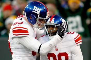 GREEN BAY, WI - DECEMBER 26:  Hakeem Nicks #88 of the New York Giants is congratulated by Kevin Boss #89 after scoring a touchdown against the Green Bay Packers at Lambeau Field on December 26, 2010 in Green Bay, Wisconsin.  (Photo by Matthew Stockman/Get