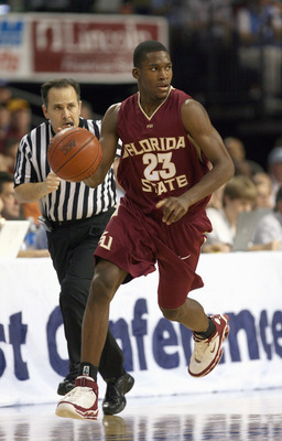 TAMPA, FL - MARCH 9: Toney Douglas #23 of the Florida State Seminoles drives upcourt against the North Carolina Tar Heels in the quarterfinals of the ACC Men's Basketball Tournament at the St. Pete Times Forum on March 9, 2007 in Tampa, Florida. The Tar H