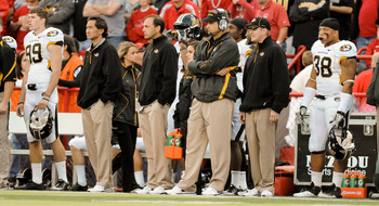 LINCOLN, NE - OCTOBER 30: Coach Gary Pinkel of the Missouri Tigers (with headset) stands with his staff during second half action of their game at Memorial Stadium on October 30, 2010 in Lincoln, Nebraska. Nebraska Defeated Missouri 31-17. (Photo by Eric