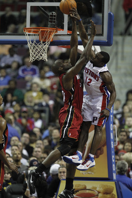 AUBURN HILLS, MI - FEBRUARY 11:  Will Bynum #12 of the Detroit Pistons tries to dunk over Joel Anthony #50 of the Miami Heat at The Palace of Auburn Hills on February 11, 2011 in Auburn Hills, Michigan.  (Photo by Gregory Shamus/Getty Images)