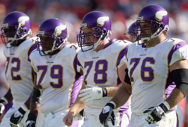 SAN FRANCISCO - NOVEMBER 5: Marcus Johnson #72, Artis Hicks #79, Matt Birk #78 and Steve Hutchinson #76 of the Minnesota Vikings walk to the line of scrimmage during the NFL game against the San Francisco 49ers at Monster Park on November 5, 2006 in San F