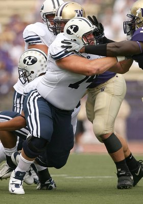 SEATTLE - SEPTEMBER 6:  Travis Bright #74 of the BYU Cougars locks up in a block with Donald Butler #9 of the Washington Huskies during their game on September 6, 2008 at Husky Stadium in Seattle, Washington. The Cougars defeated the Huskies 28-27. (Photo