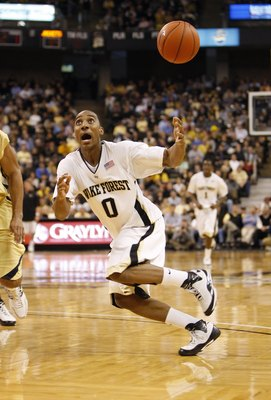 WINSTON-SALEM, NC - FEBRUARY 18:  Jeff Teague #0 of the Wake Forest Demon Deacons looks to control the loose ball during their game against the Georgia Tech Yellow Jackets at Lawrence Joel Coliseum on February 18, 2009 in Winston-Salem, North Carolina. Th