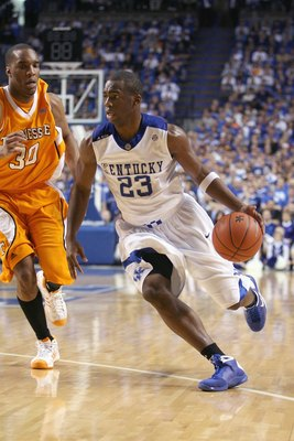 LEXINGTON, KY - FEBRUARY 21: Jodie Meeks #23 of the Kentucky Wildcats drives the ball against J.P. Prince #30 the Tennessee Volunteers during the SEC game  at Rupp Arena on February 21, 2009 in Lexington, Kentucky.  (Photo by Andy Lyons/Getty Images)