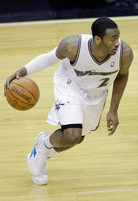 WASHINGTON, DC - MARCH 14: John Wall #2 of the Washington Wizards dribbles against the Oklahoma City Thunder during the second half at the Verizon Center on March 14, 2011 in Washington, DC. NOTE TO USER: User expressly acknowledges and agrees that, by do