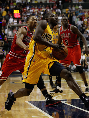INDIANAPOLIS, IN - APRIL 23: Darren Collison #2 of the Indiana Pacers drives past Derrick Rose #1 of the Chicago Bulls in Game Four of the Eastern Conference Quarterfinals in the 2011 NBA Playoffs at Conseco Fieldhouse on April 23, 2011 in Indianapolis, I
