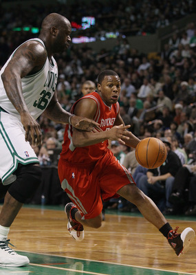 BOSTON, MA - JANUARY 10:  Kyle Lowry #7 of the Houston Rockets drives around Shaquille O'Neal #37 of the Boston Celtics on January 10, 2011 at the TD Garden in Boston, Massachusetts.  The Rockets defeated the Celtics 108-102. NOTE TO USER: User expressly