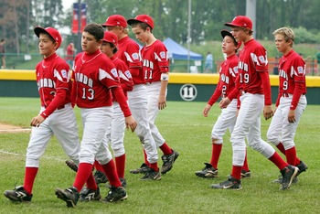 SOUTH WILLIAMSPORT, PA - AUGUST 22: Members of the Canadian team from White Rock, British Columbia walk on the field after losing to the Caribbean team from Willemstad, Curacao during their tournament game in the Little League World Series on August 22, 2