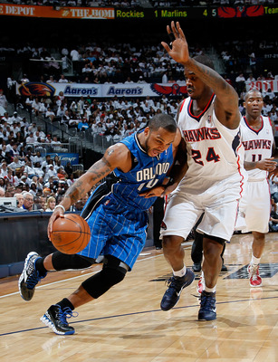 ATLANTA, GA - APRIL 22:  Jameer Nelson #14 of the Orlando Magic draws a foul from Marvin Williams #24 of the Atlanta Hawks during Game Three of the Eastern Conference Quarterfinals in the 2011 NBA Playoffs at Philips Arena on April 22, 2011 in Atlanta, Ge