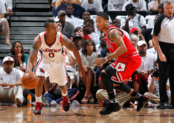 ATLANTA, GA - MAY 12:  Jeff Teague #0 of the Atlanta Hawks against the Derrick Rose #1 of the Chicago Bulls in Game Six of the Eastern Conference Semifinals in the 2011 NBA Playoffs at Phillips Arena on May 12, 2011 in Atlanta, Georgia.  NOTE TO USER: Use