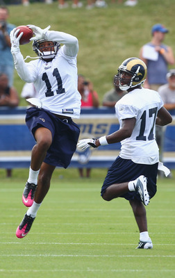 EARTH CITY, MO - JULY 31:  Brandon Gibson #11 of the St. Louis Rams hauls in a pass against teammate Donnie Avery #17 during training camp at the Russell Training Center on July 31, 2011 in Earth City, Missouri.  (Photo by Dilip Vishwanat/Getty Images)