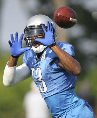 ALLEN PARK, MI - AUGUST 01: Nate Burleson #13 of the Detroit Lions goes through the days passing drills at the Lions training facility on August 1, 2011 in Allen Park, Michigan.  (Photo by Leon Halip/Getty Images)