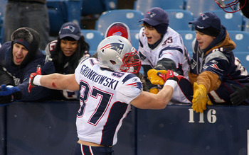 ORCHARD PARK, NY - DECEMBER 26: Rob Gronkowski #87 of the New England Patriots celebrates with fans after playing the Buffalo Bills at Ralph Wilson Stadium on December 26, 2010 in Orchard Park, New York. Gronkowski is a Buffalo native and had two touchdow