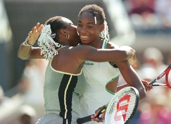 Serena (l) and Venus celebrate winning the doubles title
