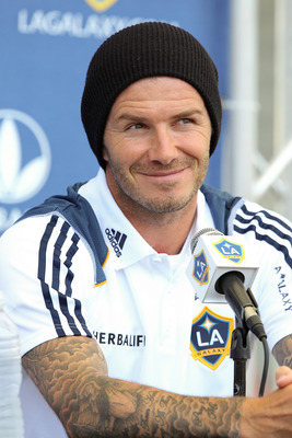 CARSON, CA - AUGUST 19:  David Beckham #23 of the Los Angeles Galaxy reacts during a news conference to announce the newly acquired Los Angeles Galaxy forward Robbie Keane #14 at The Home Depot Center on August 19, 2011 in Carson, California. Keane, who i