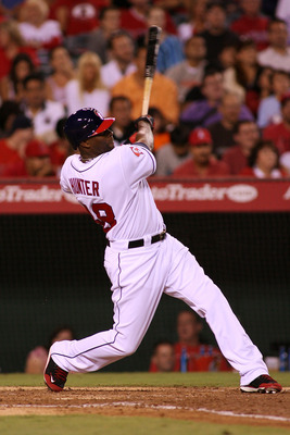 ANAHEIM, CA - AUGUST 05:  Torii Hunter #48 of the Los Angeles Angels of Anaheim doubles against the Seattle Mariners in the fifth inning of the game at Angel Stadium on August 05, 2011 in Anaheim, California.  (Photo by Jeff Golden/Getty Images)