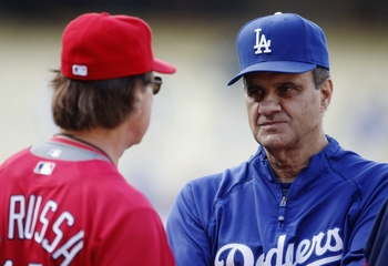 LOS ANGELES, CA - AUGUST 19:  Manager Joe Torre of the Los Angeles Dodgers talks to Manager Tony La Russa of the St. Louis Cardinals prior to the game at Dodger Stadium on August 19, 2009 in Los Angeles, California.  (Photo by Jeff Gross/Getty Images)