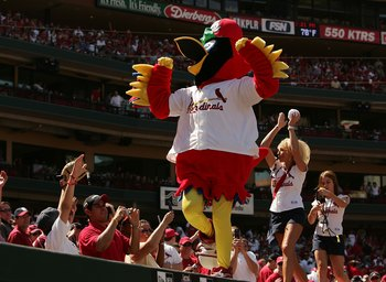 ST. LOUIS - APRIL 13:  Fredbird, the mascot for the St. Louis Cardinals, tries to get the fans into the game on April 13, 2006 at the Busch Stadium in St. Louis, Missouri. The Milwaukee Brewers defeated the Cardinals 4-3 in 11 innings.  (Photo by Elsa/Get
