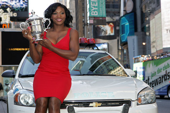 Serena shows the trophy off once again