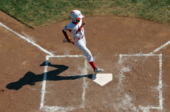 SOUTH WILLAMSPORT, PA - AUGUST 29:  Ryosuke Sugawara #9 of the Japan Little League team scores the first run of the game against United States on August 29, 2010 in South Willamsport, Pennsylvania. Japan went on to win the Little League World Series Champ