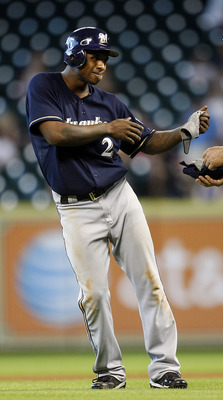 HOUSTON - AUGUST 07:  Nyjer Morgan #2 of the Milwaukee Brewers horeses around with first base coach Garth Iorg during  a baseball game against the Houston Astros at Minute Maid Park on August 7, 2011 in Houston, Texas. Milwaukee won 7-3.  (Photo by Bob Le