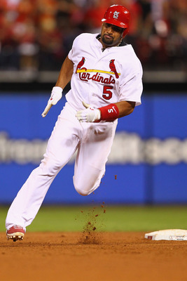 ST. LOUIS, MO - AUGUST 11: Albert Pujols #5 of the St. Louis Cardinals heads to third base after a fielding error by the Milwaukee Brewers at Busch Stadium on August 11, 2011 in St. Louis, Missouri.  The Cardinals beat the Brewers 5-2.  (Photo by Dilip Vi