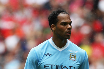 LONDON, ENGLAND - AUGUST 07:  Joleon Lescott of Manchester City looks on during the FA Community Shield match sponsored by McDonald's between Manchester City and Manchester United at Wembley Stadium on August 7, 2011 in London, England.  (Photo by Clive R