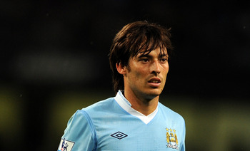 MANCHESTER, ENGLAND - AUGUST 15:  David Silva of Manchester City looks on during the Barclays Premier League match between Manchester City and Swansea City at Etihad Stadium on August 15, 2011 in Manchester, England.  (Photo by Chris Brunskill/Getty Image