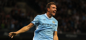MANCHESTER, ENGLAND - AUGUST 15:  Edin Dzeko of Manchester City celebrates after scoring the opening goal during the Barclays Premier League match between Manchester City and Swansea City at Etihad Stadium on August 15, 2011 in Manchester, England.  (Phot