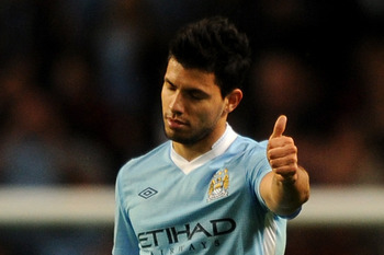 MANCHESTER, ENGLAND - AUGUST 15:  Sergio Aguero of Manchester City gives the thumbs up after scoring his side's second goal during the Barclays Premier League match between Manchester City and Swansea City at Etihad Stadium on August 15, 2011 in Mancheste