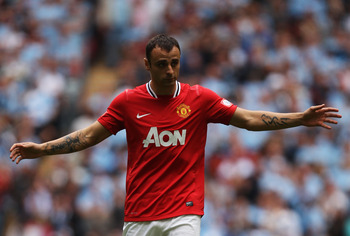 LONDON, ENGLAND - AUGUST 07:  Dimitar Berbatov of Manchester United reacts during the FA Community Shield match sponsored by McDonald's between Manchester City and Manchester United at Wembley Stadium on August 7, 2011 in London, England.  (Photo by Ian W