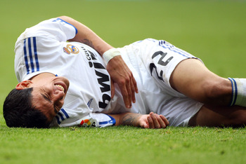 MADRID, SPAIN - APRIL 30:  Angel Di Maria lies on the pitch after a tackle during the La Liga match between Real Madrid and Real Zaragoza at Estadio Santiago Bernabeu on April 30, 2011 in Madrid, Spain.  (Photo by Julian Finney/Getty Images)