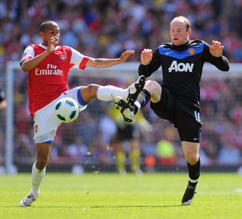 LONDON, ENGLAND - MAY 01:  Gael Clichy of Arsenal battles with Wayne Rooney of Manchester United during the Barclays Premier League match between Arsenal and Manchester United at the Emirates Stadium on May 1, 2011 in London, England.  (Photo by Mike Hewi