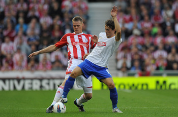 STOKE ON TRENT, ENGLAND - JULY 28:  Ryan Shawcross of Stoke City tackles Ante Vukusic of Hajduk Split during the Europa League 3rd Qualifying round first leg between Stoke City and Hajduk Split at Britannia Stadium on July 28, 2011 in Stoke on Trent, Engl