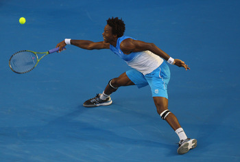 MELBOURNE, AUSTRALIA - JANUARY 21:  Gael Monfils of France stretches for a forehand in his third round match against Stanislas Wawrinka of Switzerland during day five of the 2011 Australian Open at Melbourne Park on January 21, 2011 in Melbourne, Australi