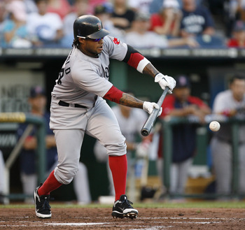 KANSAS CITY, MO - AUGUST 20:  Darnell McDonald #54 of the Boston Red Sox singles on a bunt down the third base line in the third inning during a game against the Kansas City Royals at Kauffman Stadium on August 20, 2011 in Kansas City, Missouri. (Photo by