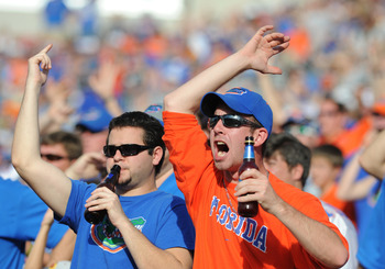 TAMPA, FL - JANUARY 1:  Fans of the Florida Gators cheer play  against the Penn State Nittany Lions January 1, 2011 in the 25th Outback Bowl at Raymond James Stadium in Tampa, Florida.  (Photo by Al Messerschmidt/Getty Images)