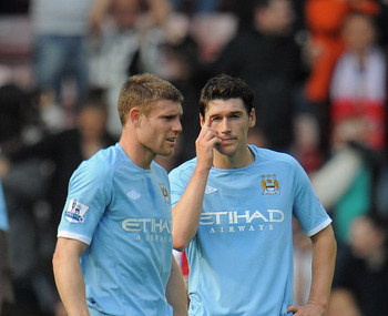 SUNDERLAND, ENGLAND - AUGUST 29: Gareth Barry and James Milner look dejected after Sunderland's goal during the Barclays Premier League match between Sunderland and Manchester City at the Stadium of Light on August 29, 2010 in Sunderland, England.  (Photo