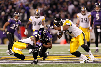 BALTIMORE, MD - DECEMBER 05:  Wide receiver Derrick Mason #85 of the Baltimore Ravens is tackled by safety Ryan Clark #25 of the Pittsburgh Steelers during the second quarter of the game at M&T Bank Stadium on December 5, 2010 in Baltimore, Maryland. Pitt