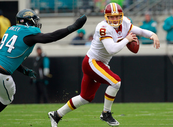 JACKSONVILLE, FL - DECEMBER 26: Quarterback Rex Grossman #8 of the Washington Redskins is pressured by Jeremy Mincey #94 of the Jacksonville Jaguars during the game at EverBank Field on December 26, 2010 in Jacksonville, Florida.  (Photo by Sam Greenwood/