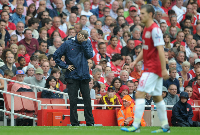 LONDON, ENGLAND - AUGUST 20:  Arsenal manager Arsene Wenger looks dejected during the Barclays Premier League match between Arsenal and Liverpool at the Emirates Stadium on August 20, 2011 in London, England.  (Photo by Michael Regan/Getty Images)