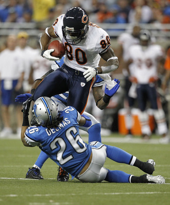 DETROIT - DECEMBER 05: Earl Bennett #80 of the Chicago Bears catches a 12 yard pass for a first down as Louis Delmas #26 of the Detroit Lions makes the stop during the game at Ford Field on December 5, 2010 in Detroit, Michigan. The Bears defeated the Lio