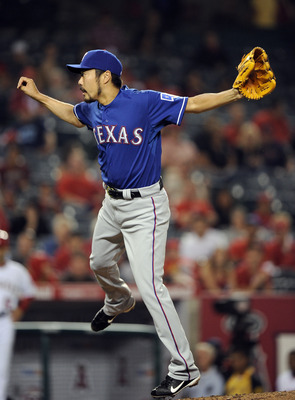 ANAHEIM, CA - AUGUST 15:  Koji Uehara #19 of the Texas Rangers pitches against the Los Angeles Angels of Anaheim during the eighth inning at Angel Stadium of Anaheim on August 15, 2011 in Anaheim, California.  (Photo by Harry How/Getty Images)