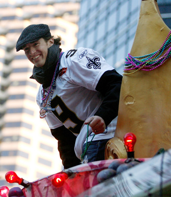 NEW ORLEANS - FEBRUARY 09:  Quarterback Drew Brees #9 of the New Orleans Saints celebrates as his team parades though the city after winning Super Bowl XLIV on February 9, 2010 in New Orleans, Louisiana.  (Photo by Sean Gardner/Getty Images)
