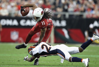 GLENDALE, AZ - DECEMBER 12:  Wide receiver Larry Fitzgerald #11 of the Arizona Cardinals makes a reception against the Denver Broncos during the NFL game at the University of Phoenix Stadium on December 12, 2010 in Glendale, Arizona.  (Photo by Christian