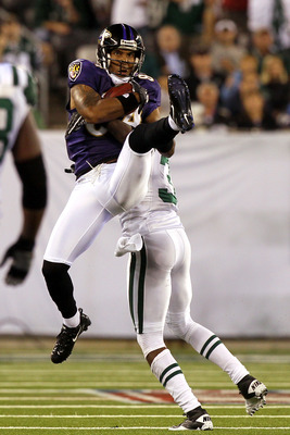 EAST RUTHERFORD, NJ - SEPTEMBER 13:  T.J. Houshmandzadeh #84 of the Baltimore Ravens catches a pass against the New York Jets during their home opener at the New Meadowlands Stadium on September 13, 2010 in East Rutherford, New Jersey.  (Photo by Jim McIs