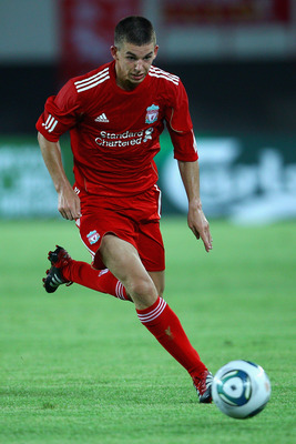 GUANGZHOU, CHINA - JULY 13:  John Flanagan of Liverpool controls the ball during the pre-season friendly match between Guangdong Sunray Cave and Liverpool at Guangdong Provincial People's Stadium on July 13, 2011 in Guangzhou, China.  (Photo by Feng Li/Ge