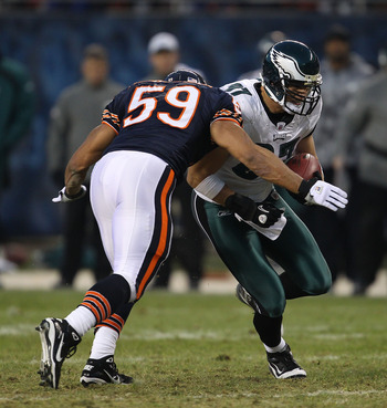 CHICAGO - NOVEMBER 28: Pisa Tinoisamoa #59 of the Chicago Bears moves to tackle Brent Celek #87 of the Philadelphia Eagles at Soldier Field on November 28, 2010 in Chicago, Illinois. The Bears defeated the Eagles 31-26. (Photo by Jonathan Daniel/Getty Ima