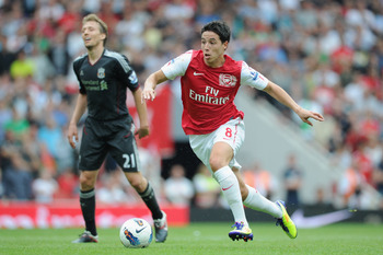 LONDON, ENGLAND - AUGUST 20:  Samir Nasri of Arsenal runs with the ball during the Barclays Premier League match between Arsenal and Liverpool at the Emirates Stadium on August 20, 2011 in London, England.  (Photo by Michael Regan/Getty Images)