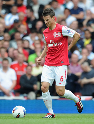 LONDON, ENGLAND - AUGUST 20:  Laurent Koscielny of Arsenal pulls up with an injury during the Barclays Premier League match between Arsenal and Liverpool at the Emirates Stadium on August 20, 2011 in London, England.  (Photo by Michael Regan/Getty Images)